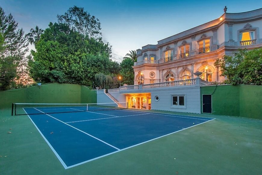 If you have uneven landscaping you can build a tennis court lowered into the ground. This lets people above the tennis court observe the match as well as saves you the trouble of building a fence.
