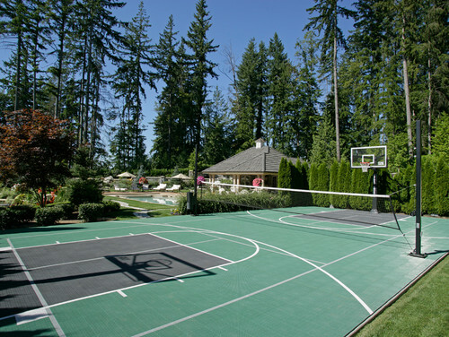 Here is a tennis court that has two basketball hoops so that it can transform into a full basketball court. This is perfect for the sports fan who wants to be able to practice both sports on a regular basis.