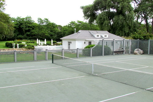 Here is a simple tennis court. There is no need for complicated buildings or pavilions if you are simply looking to build a place for you to practice and hone your tennis skills.