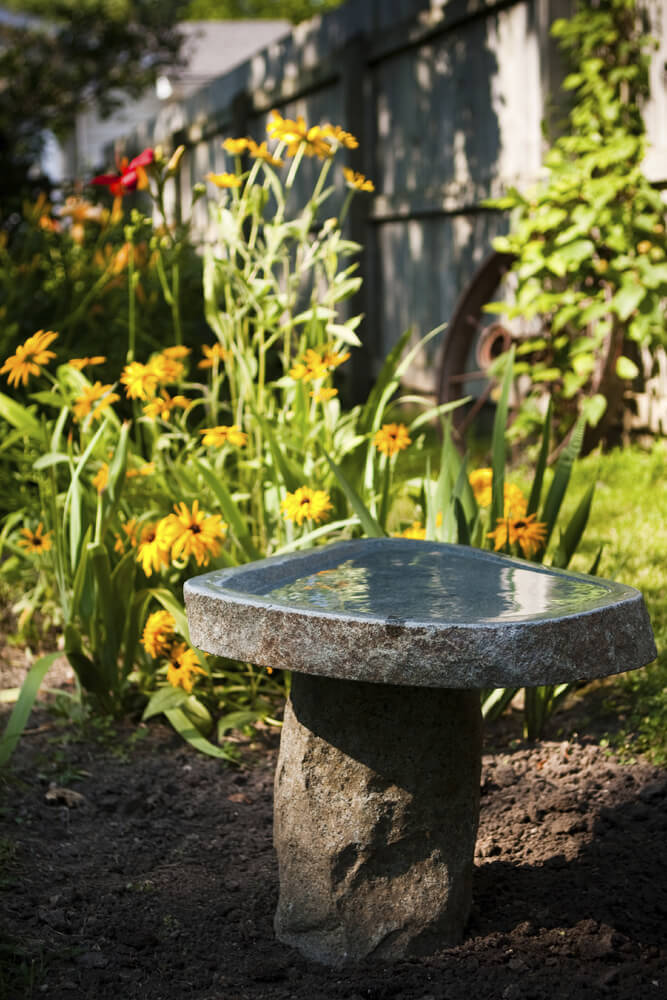This bird bath is made of one carved stone placed on top of another. This is perfect for maintaining a natural and rugged appeal.