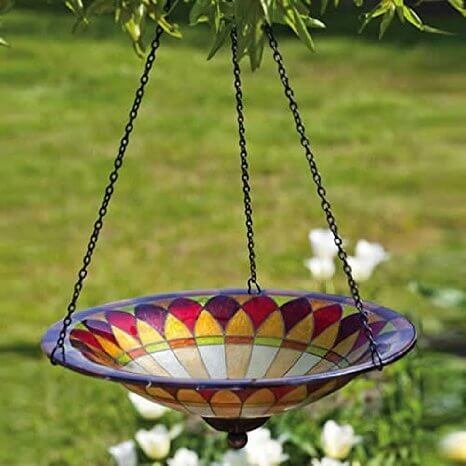 Here is a hanging glass bird bath. It has a great color with patterns that bring some extra flash to the area. This is for those who appreciate extravagant and stunning color palettes.