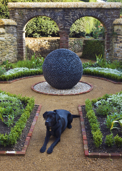 Here is an amazing sculpture used as a centerpiece. If you have a large or interesting piece you can place it in the center of your space and have the rest of the yard focused around that object.