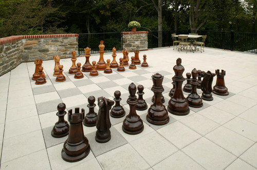 Some sculptures can even be games. These sculptures turn this patio into an oversized chess board. This is great for a lover of chess. It can show off your passion as well as lure your guests into a fun match.