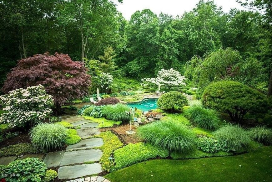 Even on a well manicured lawn you can place a number of bushes and trees to give good depth and variety to your space. You can really let your space reflect your style by the placement and types of plants chosen.