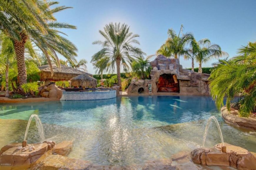 Here is a cool water park area with a grotto and two water fountains. There can be many hours of fun had here with your family and friends. Where else would you want to be on a hot sunny day?
