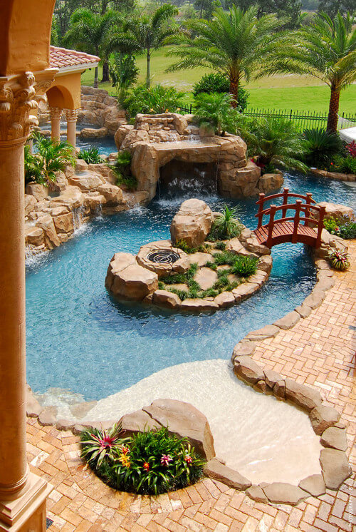 This is a stunning water park area in a backyard. By lining the entire area in stones you can give the water area an interesting natural appeal while connecting it to the rest of the masonry and brickwork.