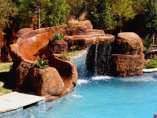 Here is a water slide and waterfall in one. This piece makes a great addition that can instantly turn a pool into a water park. This feature really brings the fun to your personal water park.