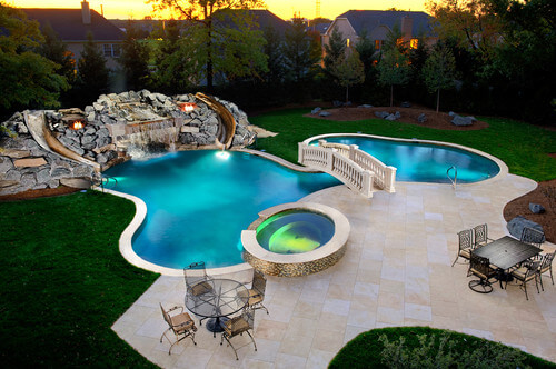 This backyard water park has two slides for double the fun. There is less need to take turns with two slides, keeping the line for the slide down and the fun continuing for hours.