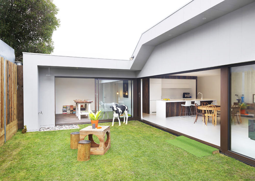 The backyard itself was made much smaller by the remodeling, but is far more useful by being connected to three major segments of the home. The large retractible glass panels create a visual and spacial connection that improves both sides.