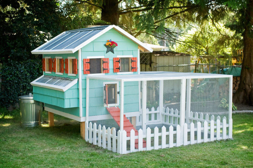 Here's another beautiful DIY chicken coop design, sporting a multicolored paint job and a rather large outdoor exercise area. The white picket fence is the adorable detail that ties it all together.