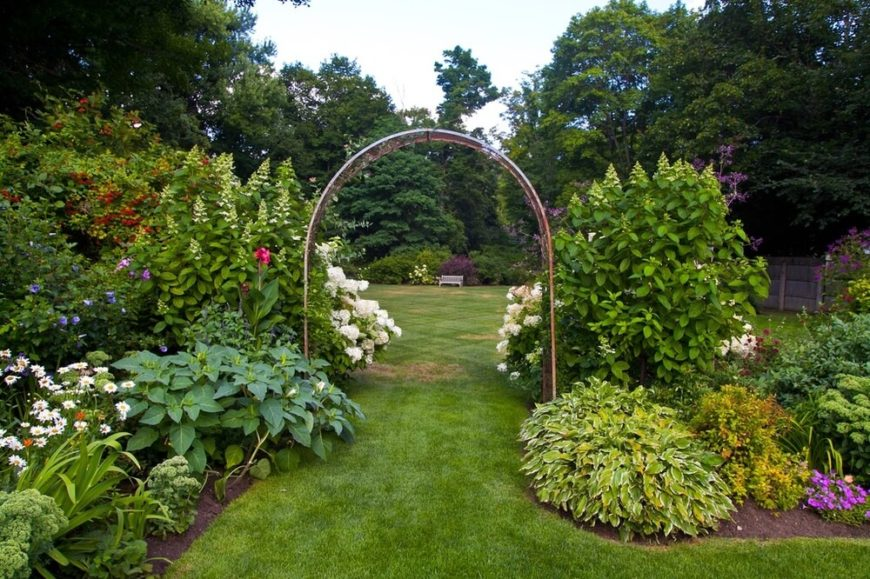 If you have a large yard you may decide to have an archway that you want people to pass through. What better way to ensure that people use the proper archway than to funnel them with a large garden?