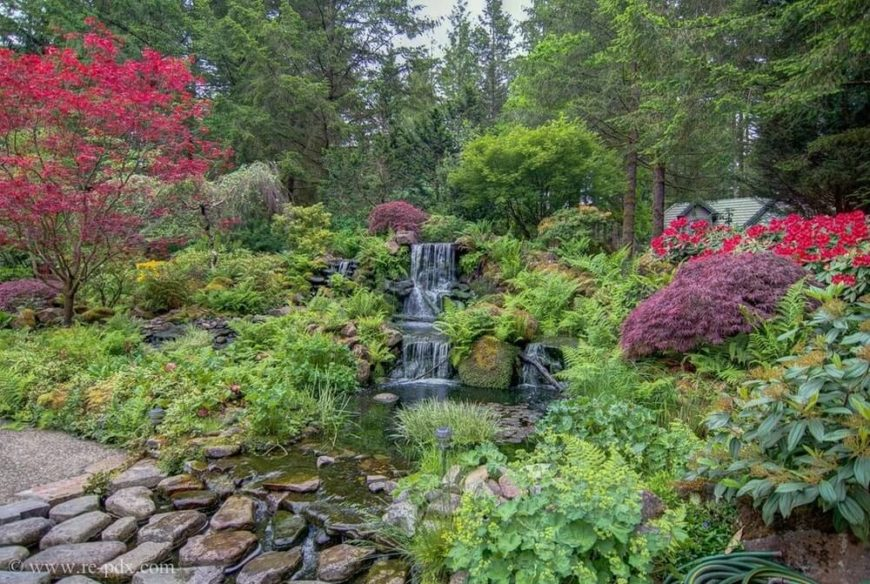 Large gardens are great at surrounding and highlighting other features. Here we see a waterfall feature that is enhanced by a wonderfully large garden. Water features love large gardens, and the love is mutual.