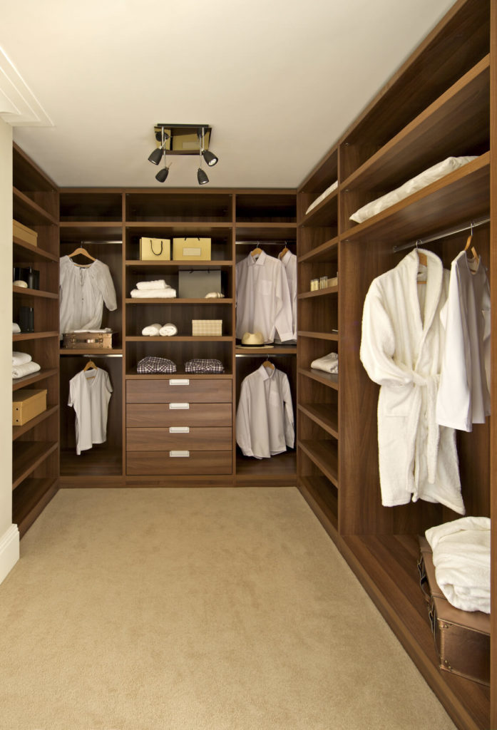 Simple walk-in closet staged to perfection.