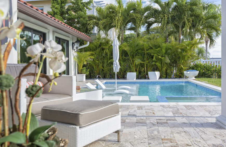 When paired with other large leafed plants, palm trees can build a great tropical themed privacy hedge. This creates a wonderful and appealing barrier while maintaining your warm beach style.