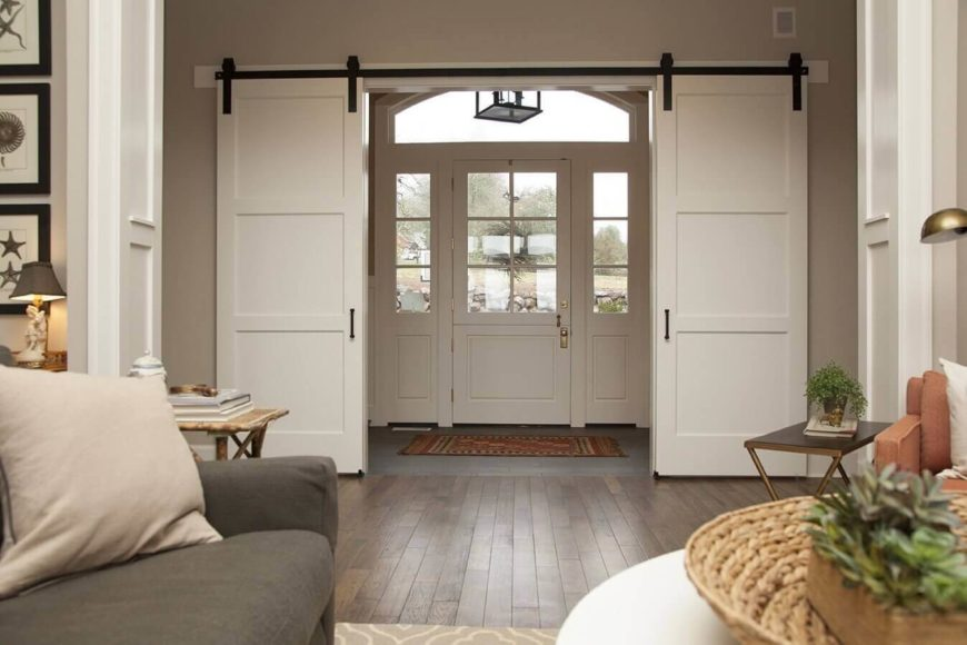 These much more contemporary white versions are used to create a French door-esque entryway into the main living area. The foyer area can easily be closed off.
