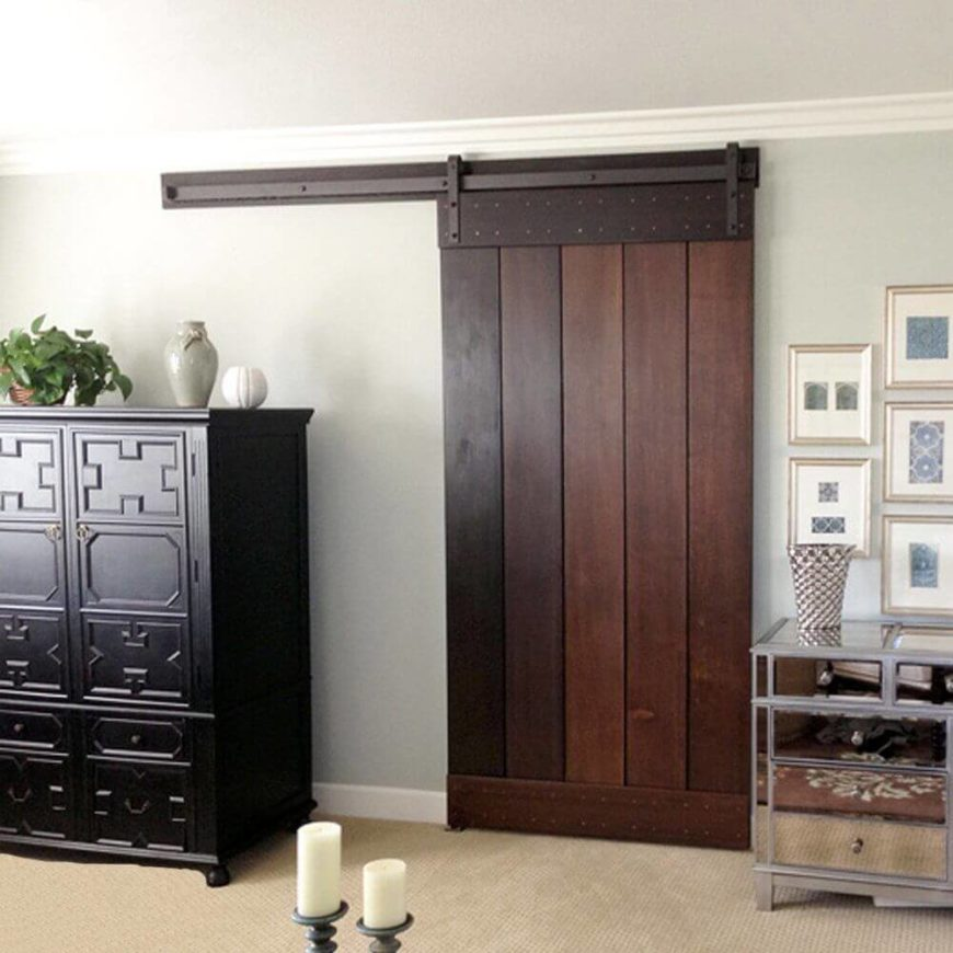 Even a rich dark wood barn door looks great! The hardware blends in beautifully with the wood and adds rich, warm tones to the contemporary space.