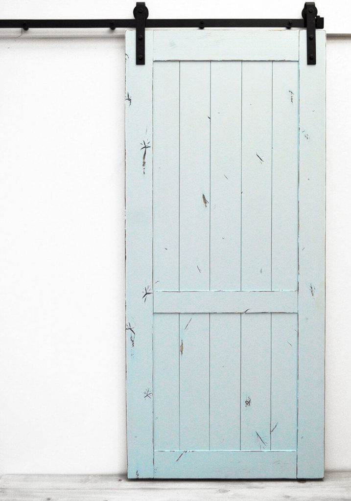 A small splash of color, like on this pale blue barn door, can make a barn door the beautiful focal point of any modern or contemporary space.