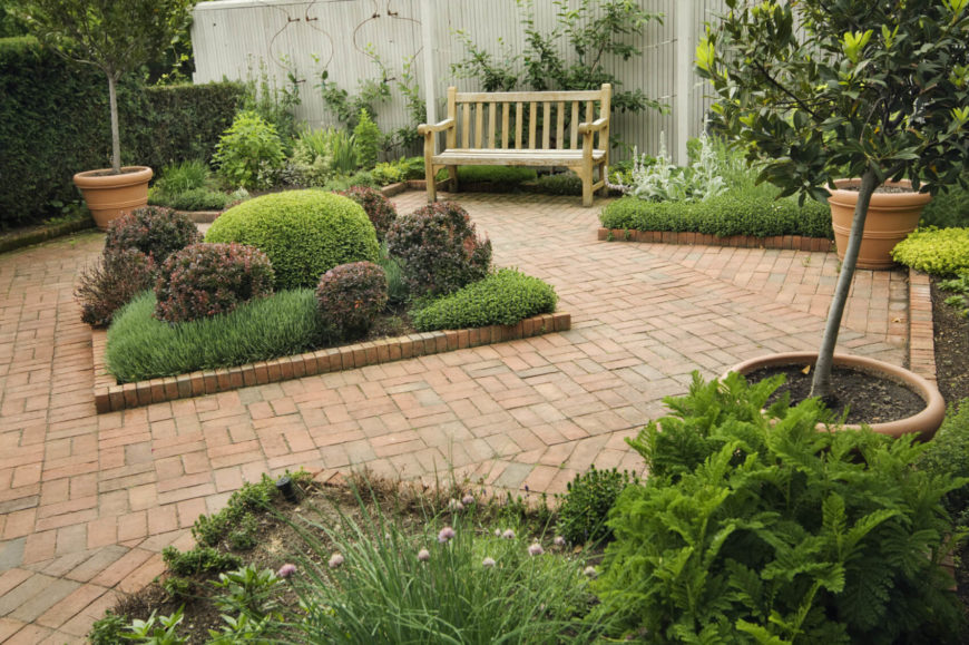 If you have an open space like a patio you can accentuate it by placing a small garden in the center. This gives the area focus and looks fantastic.