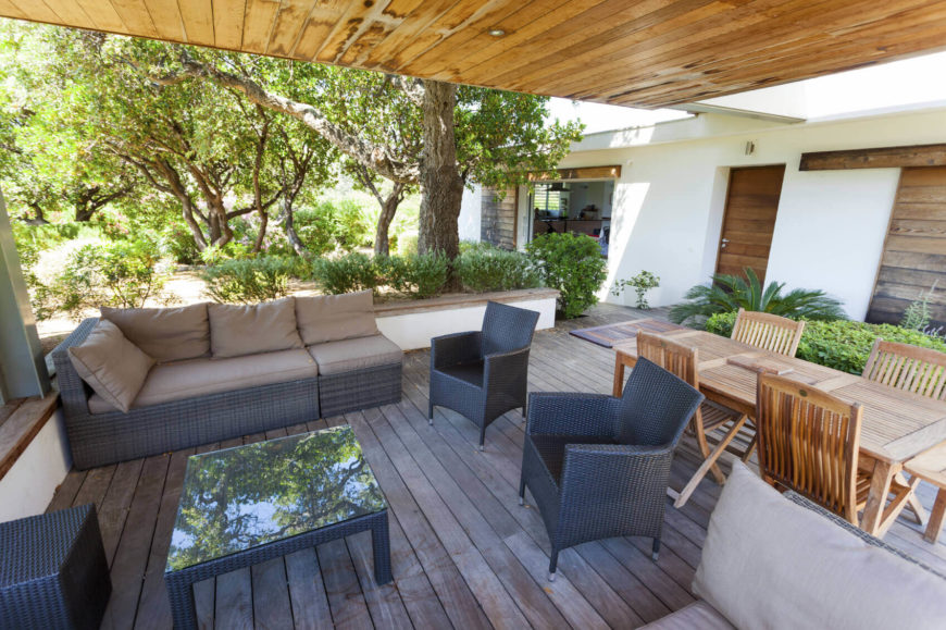You can use small gardens to divide spaces as well. This half wall is adorned with a small garden that helps divide this outdoor seating area from the rest of the yard.