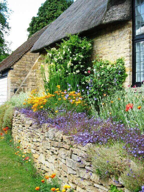 One of the best things about small gardens is that they can find in different spaces. This garden sits along the wall of this home. You are never far from your garden when it is house adjacent.
