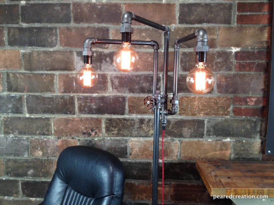 This tall floor lamp features Edison bulbs that give off a warm ambient light that is perfect to read by. The arms of the lamp are adjustable and the faucet handle is used to turn the lamp on and off. Each lamp is handcrafted and subject to small variations.
