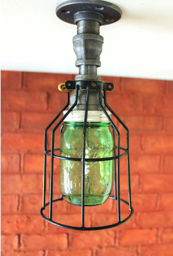 This unique light melds together several different styles, including farmhouse aesthetics and industrial style. The green glass mason jar adds a bit of color to a style that typically is monochromatic.