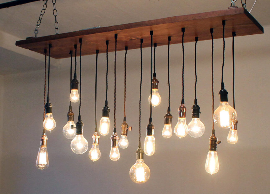 This beautiful chandelier is made with reclaimed barn wood, black antique replica cloth cords with mixed black, copper, and brass hardware. The light has 18 pendants with incandescent bulbs included.