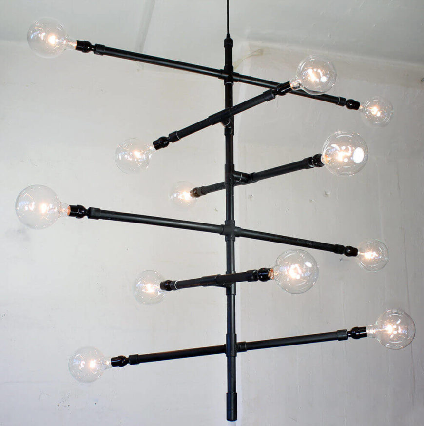 This piece features a number of extending pipes with globe lights attached. The light has twelve 25 watt bulbs, and can be customized to be larger or smaller depending on the space it is being purchased for. Each fixture is made to order in Brooklyn, NY and is made to be hardwired.