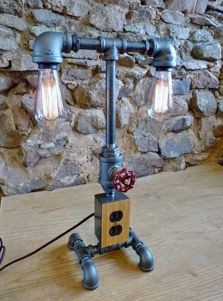 This twin-bulb model features a faucet dimmer switch and electrical outlets to enhance the functionality of this already stunning lamp. The piece includes two 60 watt light bulbs, and an 8 foot cloth-covered cord.