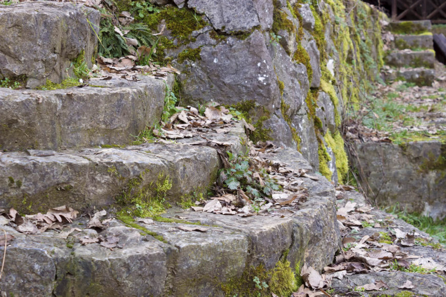 These rugged cut stone steps have a very rustic and natural appeal. They are so roughly cut that they almost look as though the stone could have naturally formed like that.