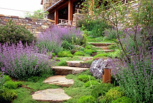 If your stone steps are made from large slabs it is easy to segway your steps into a stone walkway. This is a great way to tie your steps into your landscape.