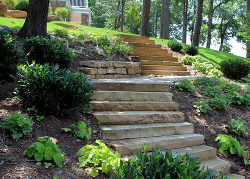 These stone steps are well carved and simple. There is no need for fancy adornment for stone steps to be functional and stylish.