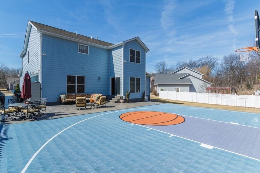 This is another angle of the previous court. Here we can see it is a half court in a nice large backyard area. This is a great half court for three on three pick up games or practicing your hook shot.