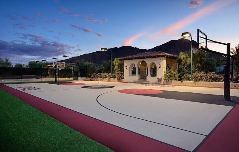 This backyard is adorned with a great full sized basketball court. This space can be used to draw a plethora of basketball lovers to your space. You can even host your own b-ball tournament here.