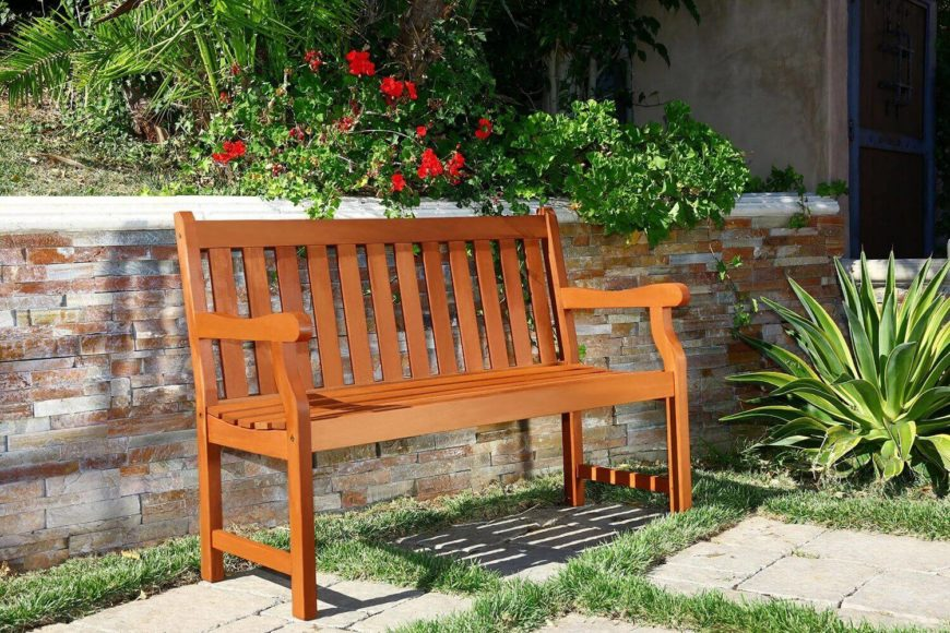 Pictured here is a classic wooden bench. This bench is great for spending time out in the garden or on a patio under an awning. This bench can hold two people comfortably. It is near the low end of the cost range so it is also quite affordable.