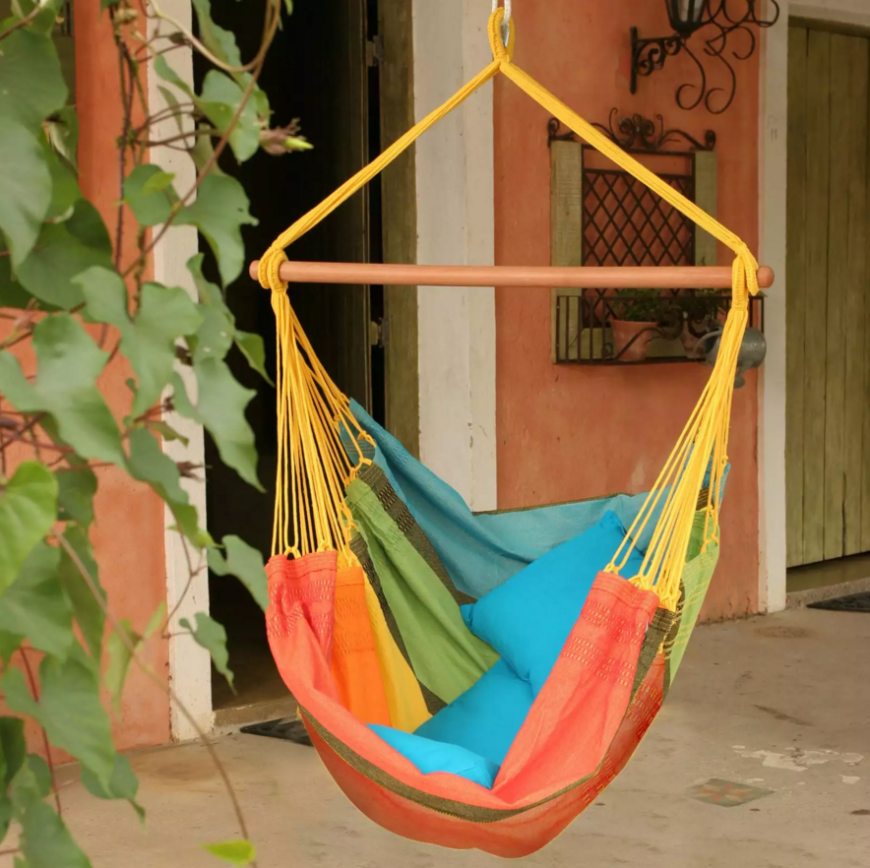 Here is another suspended chair with a hammock-like construction. The closeness of the rope tie points bunches the cloth into a chair shape that is both cozy and enveloping.