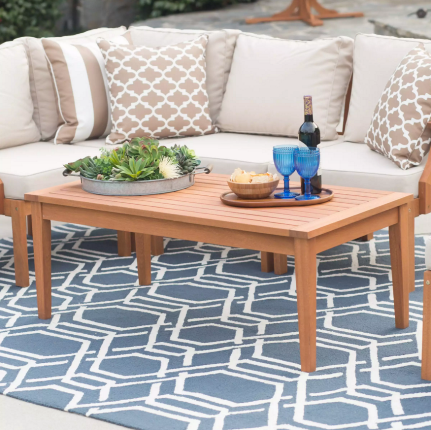 Here is a simple wooden outdoor coffee table. With a simple coffee table such as this you can be sure that it will fit in with the rest of your pieces. The simplicity of this piece makes it universally appealing.