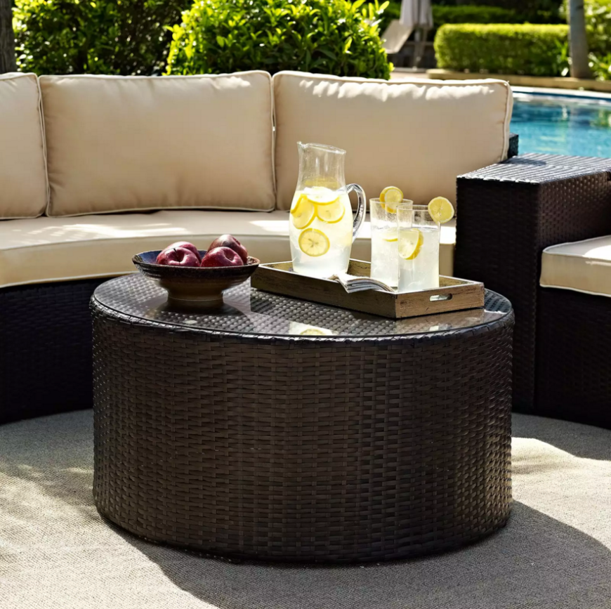 Woven wicker tables with glass tops make for great outdoor furniture that can withstand the elements and look fantastic for a long time.