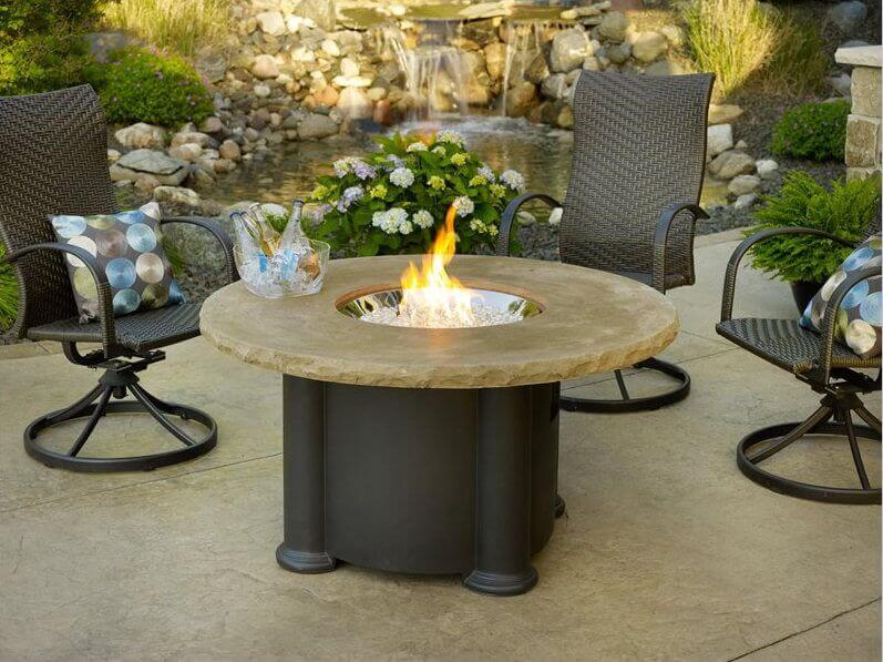 Here is a high end round table with a wonderful fire pit piece in the middle. Tables with features like this make great gathering spots. It is fun to sit and socialize around a fire, and your table can provide that and much more with a piece such as this.