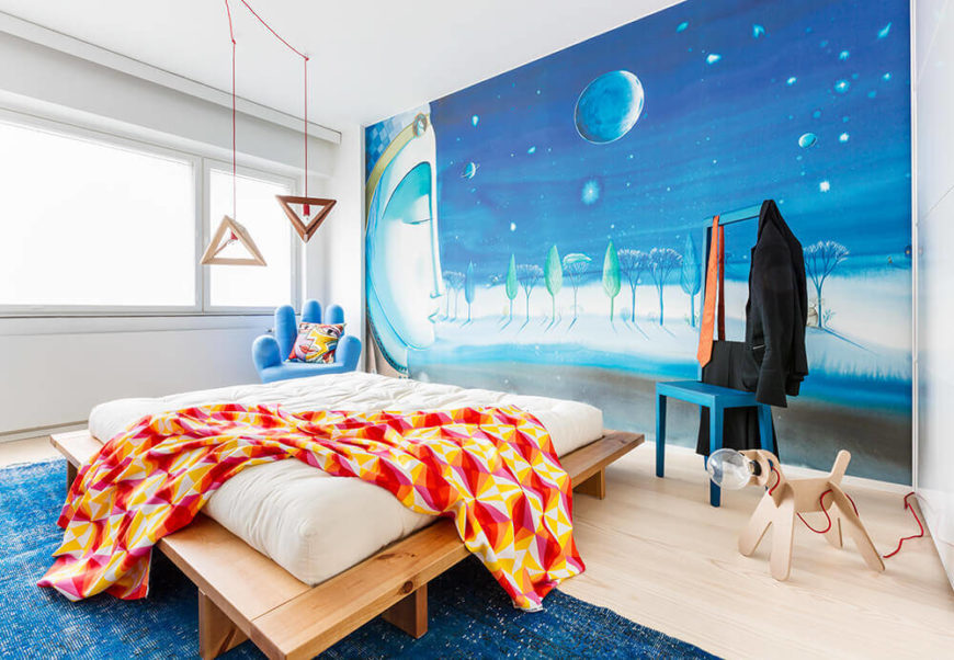 Now we reach the primary bedroom, the place where dreams are made in more ways than one. The incredible wall art dominates the room, as every design choice extends from it.