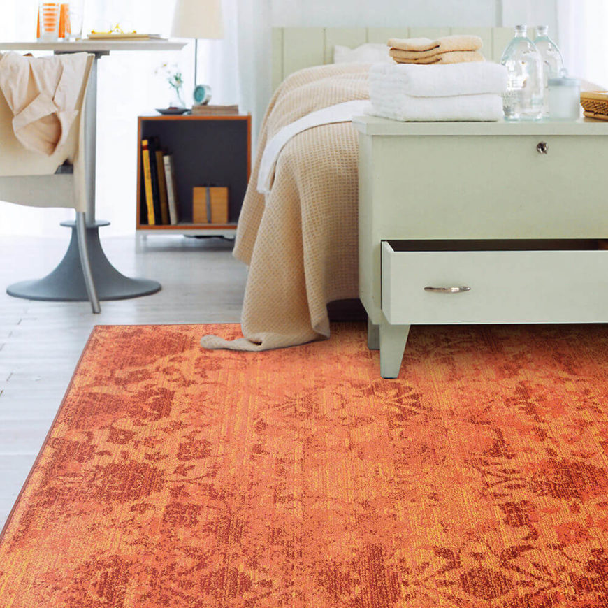 Add vibrancy and color to a neutral bedroom with a bright orange and pink rug. The ultimate choice for dressing up gray tile or dark wood floors, this rug is sure to win admiration.