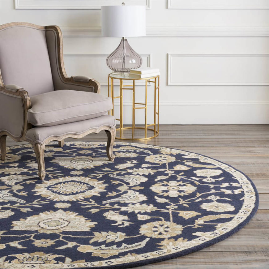 Cream and beige pop against the navy background of this colorful circle rug. Expect to garner fanfare with this trendy and unique floor rug.
