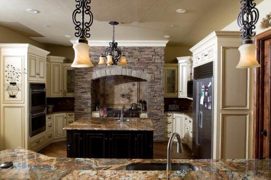 The stone oven in this Mediterranean kitchen is a perfect way to build rustic charm and texture.