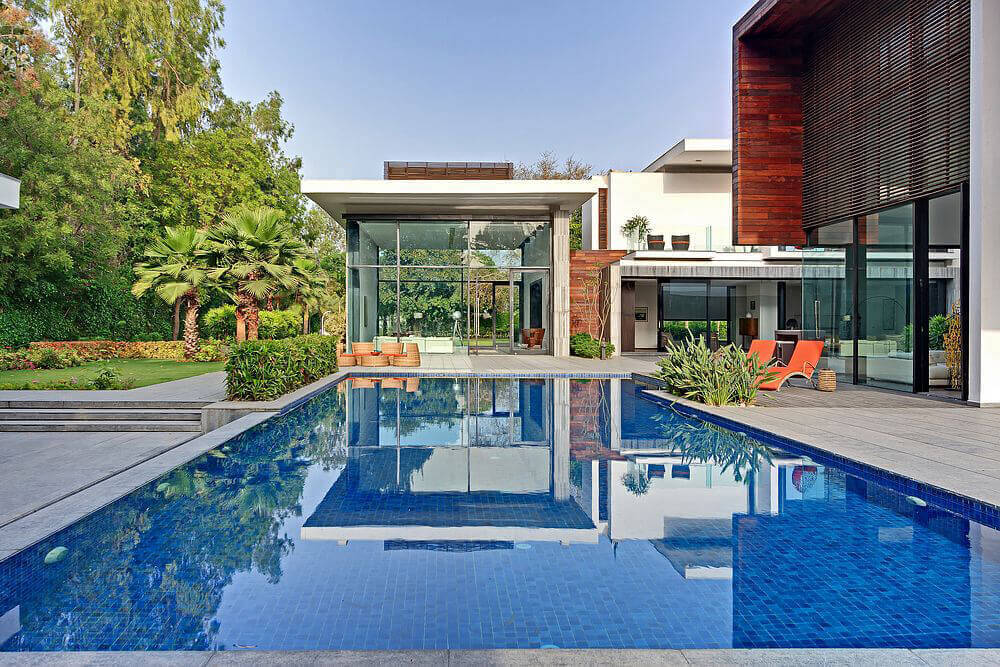 This home's swimming pool beautifully mirrors the blue skies.