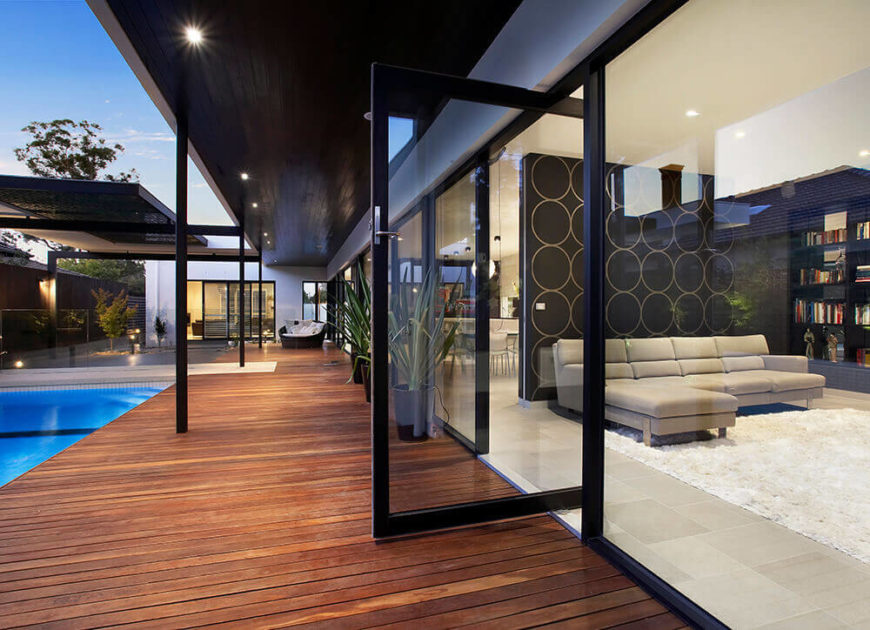 With the large glass doors fully opened, the indoor and outdoor portions of this home are completely integrated. The starkly modern interior meshes perfectly with the patio.