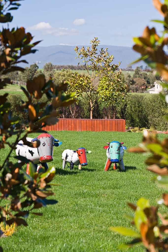 The expansive lawn has room for plenty of whimsey, courtesy of features like these cow sculptures.