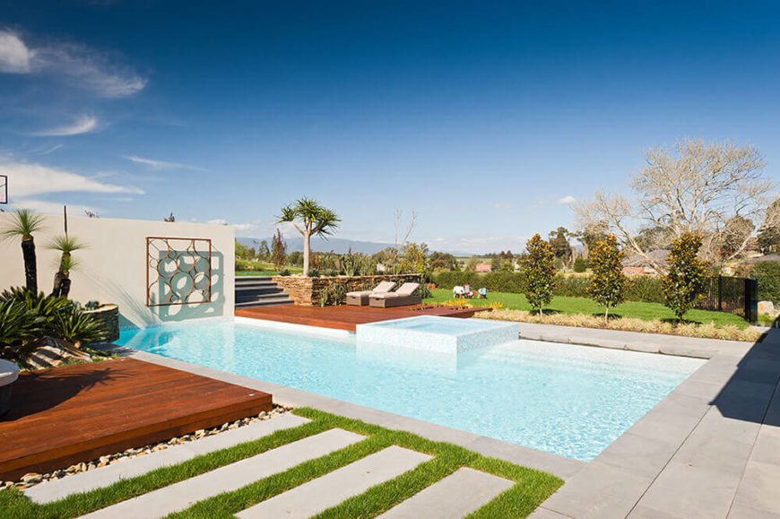 The landscape was designed to wrap around the pool, granting expansive, richly detailed views to the space while helping grant it some privacy.