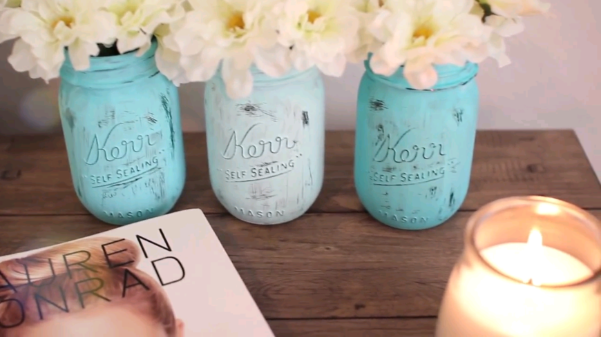 Using paint on a mason jar and filling it with flowers is a great way to make a statement, and a super easy DIY project. This DIY tutorial video covers several ways to dress up those jars!