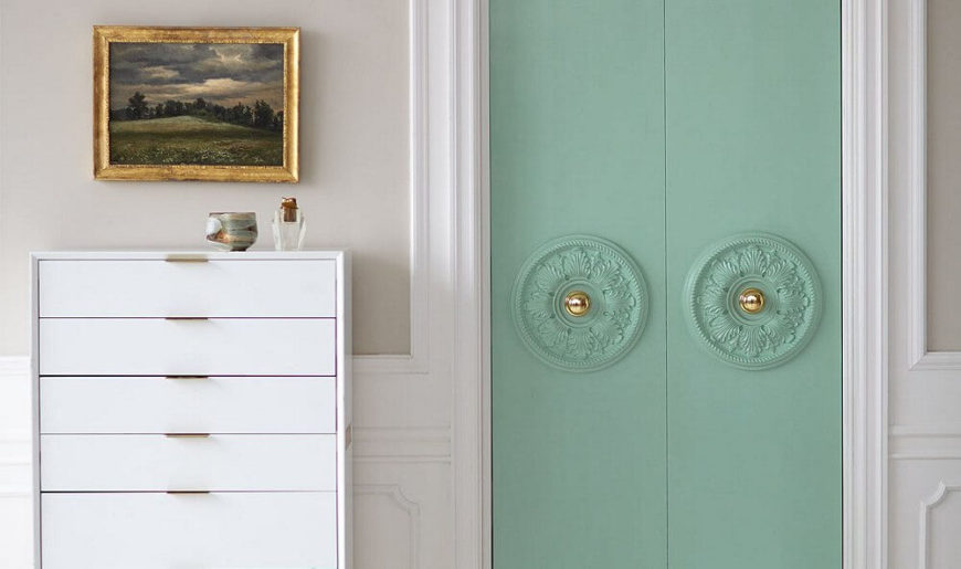 Dressing up those builder's-grade closet doors is as simple as adding plaster medallions and a fresh coat of paint!
