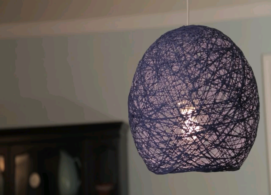 This creative take on yarn looks beautiful whether you use it as a lamp shade or as a hanging globe. Try all kinds of different colors to find the perfect look to add to your room!